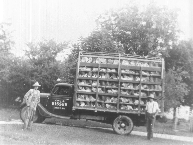 Black and white photo of an old Carl B. Risser chicken truck