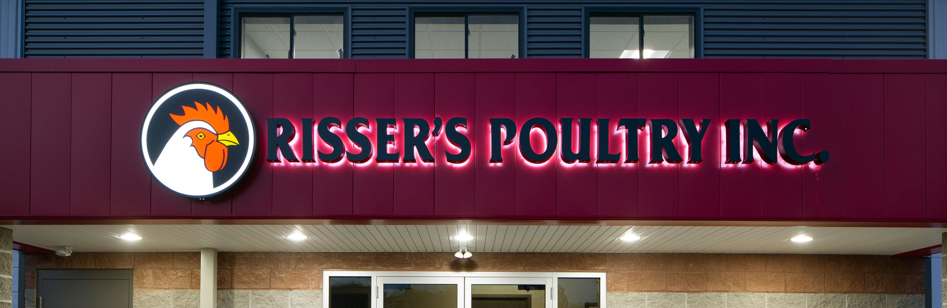 Exterior view of the Risser's Poultry Inc. sign